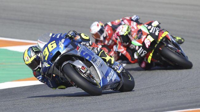 Juara bertahan MotoGP, Joan Mir, dibalap dua pembalap Ducati jelang garis finis MotoGP Qatar 2021.
