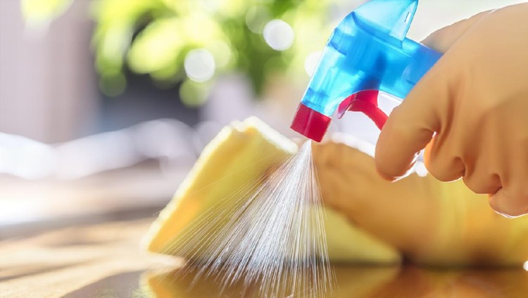 Cleaning with spray detergent, rubber gloves and dish cloth on work surface concept for hygiene