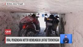 VIDEO: Viral Pemotor Membungkuk Lintasi Terowongan