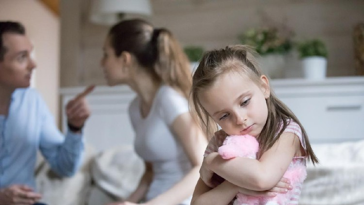 Sad little girl hug toy upset with parents fighting, frustrated small girl feel alone and depressed, mom and dad argue, lonely kid lack love and support. Psychology, family conflict, marriage break up