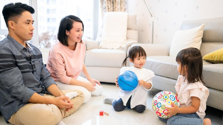 Asian family playing toys at home.