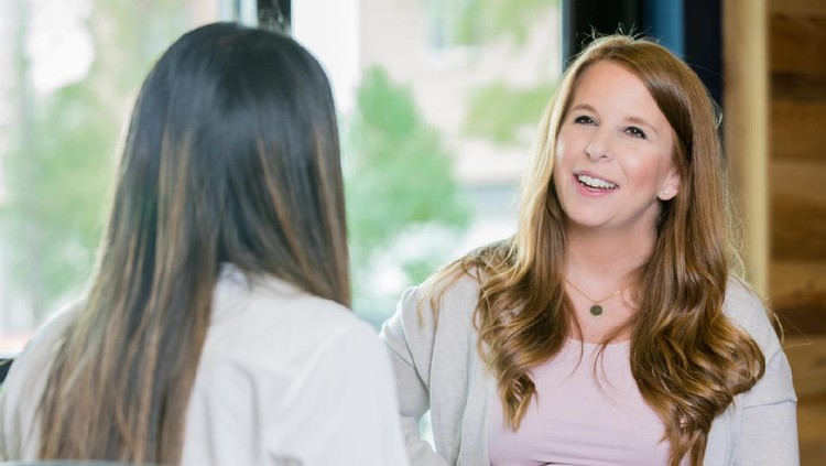 Young adult Caucasian pregnant woman is meeting with midwife or obstetrician during a childbirth class or pregnancy support group