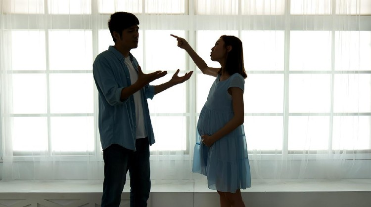 silhouette of pregnant couple arguing and quarreling at home