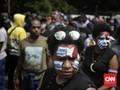 FOTO: Aksi Peringatan 1 Desember Warga Papua di Jakarta