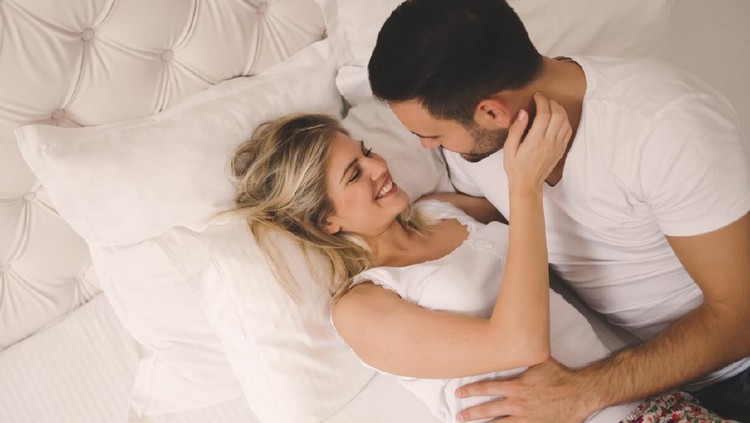 Passionate beautiful couple foreplay in bed