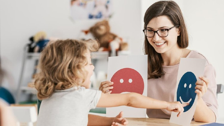 Emotion emoticons used by a psychologist during a therapy session with a child with an autism spectrum disorder.