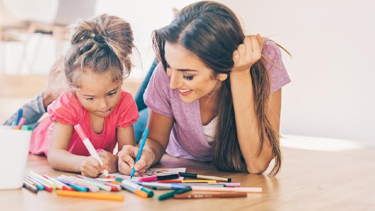 Mother and daughter coloring pages on the floor