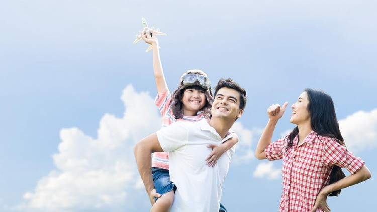 Father carry boy wearing captain hat on back, playing airplane toy in sky together with mother. Young child want to be pilot in future when he growing up. Family supports son dream job or occupation.