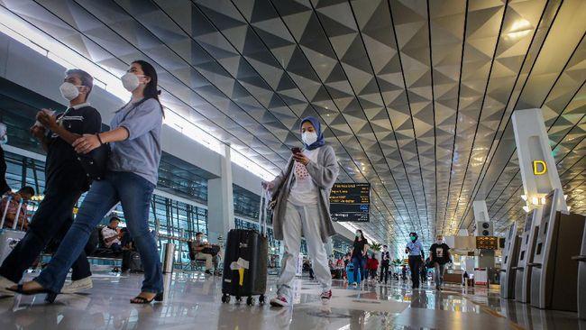 Pemerintah mempertimbangkan wisatawan asing yang masih dalam penerbangan ke RI sehingga baru menutup pintu kedatangan WNA per 1 Januari 2021.