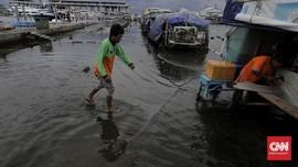 FOTO: Banjir Rob Muara Angke Sambut Tahun Baru 2021