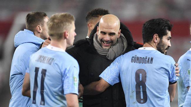 Mantel Pep Guardiola jadi bahan bully di media sosial dalam kemenangan Manchester City atas Borussia Moenchengladbach di leg pertama 16 besar Liga Champions.