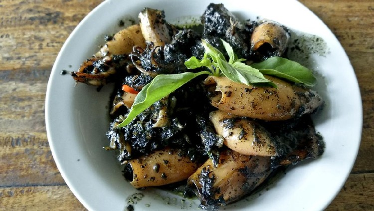 Cumi Hitam, Indonesian Traditional food. Stir Fry Calamari With Black Sauce