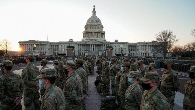Washington DC, AS, diisolasi dan dijaga ketat oleh lebih dari 20 ribu pasukan Garda Nasional bersenjata menjelang pelantikan Joe Biden.
