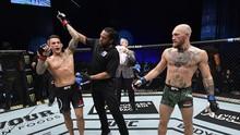 Kalah TKO, McGregor Ingin Pertarungan Ketiga Lawan Poirier
