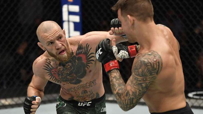 Conor McGregor menang ronde 1 atas Dustin Poirier sebelum dinyatakan kalah TKO ronde kedua pada UFC 257.