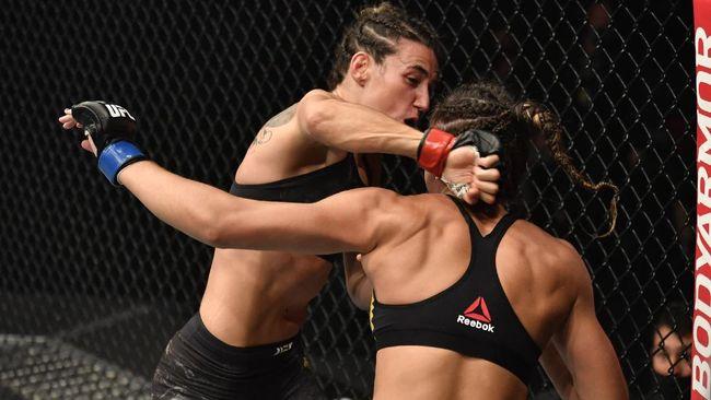 Marina Rodriguez meraih kemenangan brutal atas Amanda Ribas pada UFC 257 dengan dua kali memukul TKO lawan.
