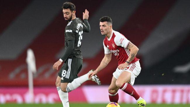 Arsenal vs Man Utd berpeluang terjadi di final Liga Europa. Berikut syarat duel tersebut bisa terwujud.