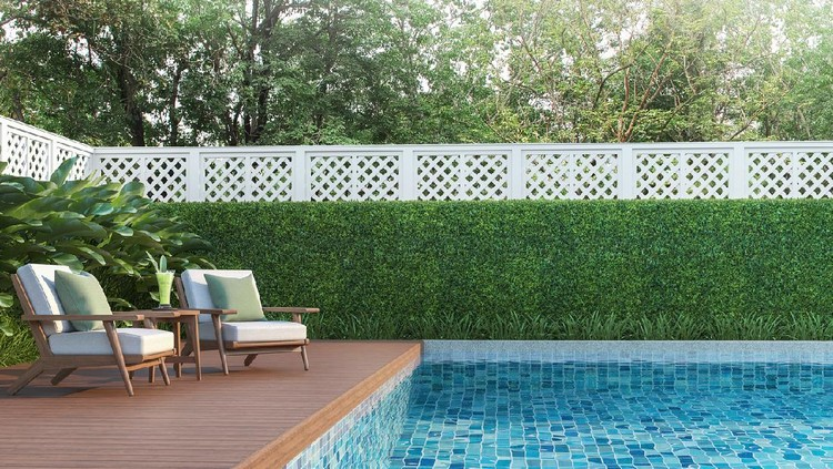 Swimming pool terrace in the garden 3d render,  There are a wooden floor ,Blue tile in the swimming pool and white fence,Decorated with wooden and white fabric furniture,Surrounded by nature.