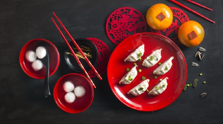 Flat lay Chinese new year food and drink still life. Texts appear in image: Prosperity, spring, good luck.