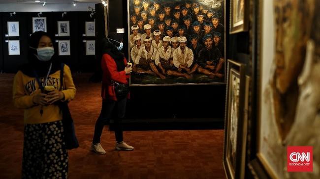 Pameran lukisan bertema Suku Baduy karya perupa Jenny Mahastuti, di gedung Perpustakaan Nasional RI, jalan Merdeka Selatan, Jakarta Pusat, Kamis (11/2).