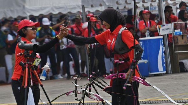 Sebuah panah yang dilepaskan Nurfitriyana Saiman menjadi penentu jalan lapang 3 Srikandi untuk membuka pintu medali Indonesia di Olimpiade.