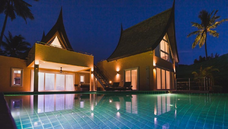 beautiful luxurious villa at twilight, luxury private expensive house with swimming pool, asian style exterior facade