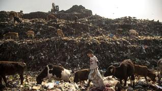 FOTO: Kisah Keseharian Bocah Pemulung di India