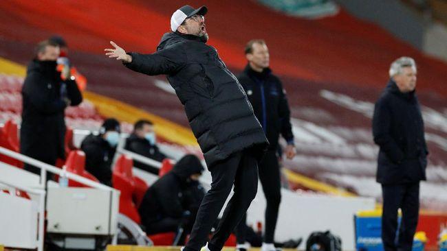 Pelatih Liverpool, Juergen Klopp, memiliki catatan kurang baik melawan Madrid sekaligus rapor merah menghadapi Zinedine Zidane.