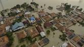 Ribuan rumah di Bekasi-Karawang terendam banjir usai tanggul Sungai Citarum di Kecamatan Pebayuran, Kabupaten Bekasi, jebol pada Sabtu (20/2) malam.