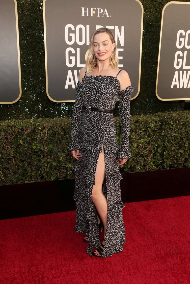 Margot Robbie poses in this handout photo from the 78th Annual Golden Globe Awards in Beverly Hills, California, U.S., February 28, 2021. Todd Williamson/NBC Handout via REUTERS ATTENTION EDITORS - THIS IMAGE HAS BEEN SUPPLIED BY A THIRD PARTY. NO RESALES. NO ARCHIVES.