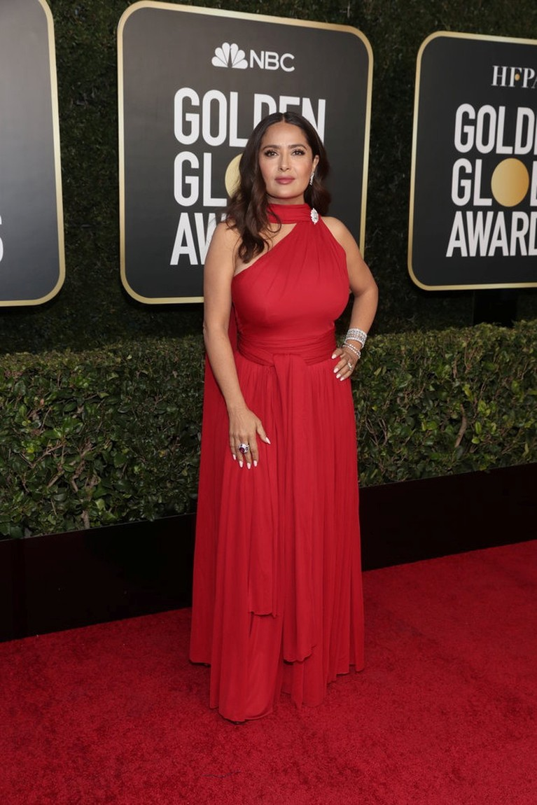 Actor Salma Hayek poses on the red carpet in this handout photo from the 78th Annual Golden Globe Awards in Beverly Hills, California, U.S., February 28, 2021. Todd Williamson/NBC Handout via REUTERS ATTENTION EDITORS - THIS IMAGE HAS BEEN SUPPLIED BY A THIRD PARTY. NO RESALES. NO ARCHIVES.