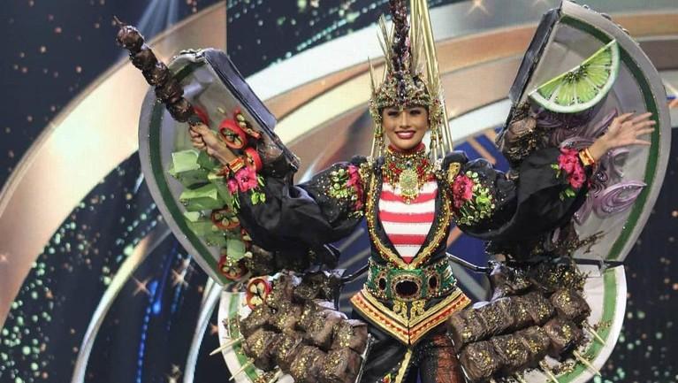 Aurra Kharishma tampil memukau dengan kostum sate di ajang Miss Grand International. Yuk, intip foto-fotonya!