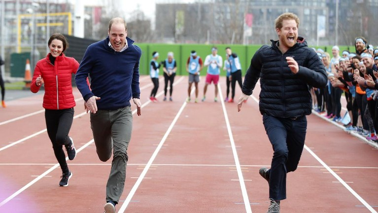 FILE - In this file photo dated Sunday, Feb. 5, 2017, Britain's Prince Harry, right, races to the line against Prince William, and Kate, the Duchess of Cambridge, left, during a training event to promote their charity Heads Together, at the Queen Elizabeth II Park in London.  Many observers believe that the upcoming funeral for Prince Philip, on Saturday April 17, 2021, will provide an ideal opportunity for the brothers to smooth over tensions.(AP Photo/Alastair Grant, Pool)