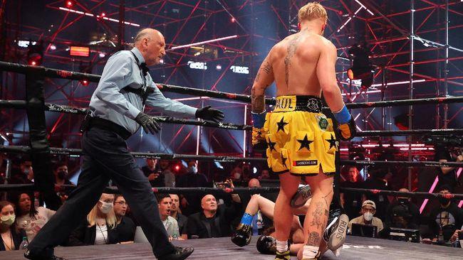 YouTuber Jake Paul menang TKO ronde pertama atas eks petarung UFC Ben Askren dalam duel tinju yang berlangsung di Stadion Mercedes-Benz, Atlanta.