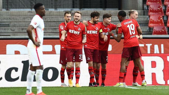 RB Leipzig gagal menempel ketat Bayern Munchen di klasemen Bundesliga setelah kalah 1-2 dari FC Koln pada pekan ke-30.
