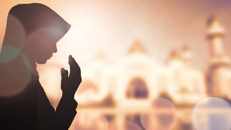 Muslim Woman pray and Beautiful background.