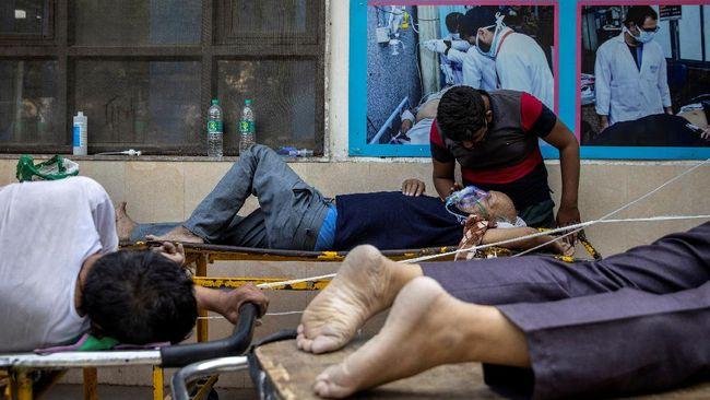 India mencatat rekor kematian harian Covid-19 tertinggi di dunia dengan 6.148 kasus mengalahkan AS, setelah menghitung ulang pasien meninggal.