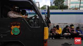 FOTO: Aksi Peringatan May Day 2021 di Jakarta