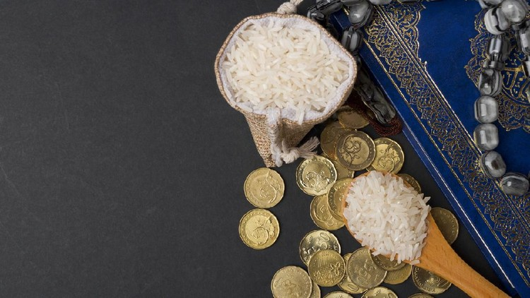 Coins, rosary, Holy Quran and rice in the sack. Zakat concept. Zakat is a form of alm-giving as a religious obligation or tax. Large Arab word right method to read correctly.