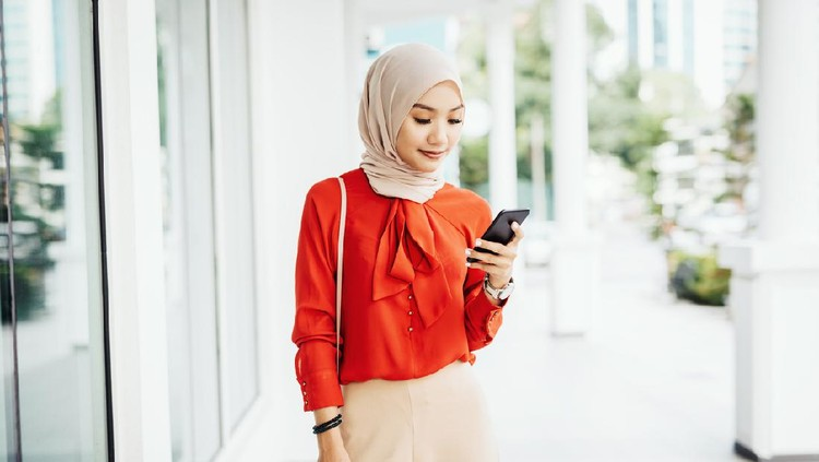 Portrait of Malaysian or Indonesian Muslim young woman with light blue colored hijab