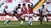 Manchester United sempat tertinggal sebelum akhirnya menang 3-1 atas Aston Villa di Liga Inggris. Simak foto-foto pilihan laga tersebut.