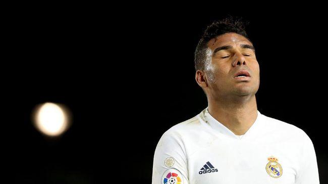 Real Madrid membuang kesempatan untuk menjadi pemuncak klasemen Liga Spanyol setelah hanya bermain imbang 2-2 lawan Sevilla.