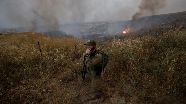 Israel menambah pasukan ke perbatasan Jalur Gaza setelah saling serang dengan kelompok milisi Palestina, Hamas.
