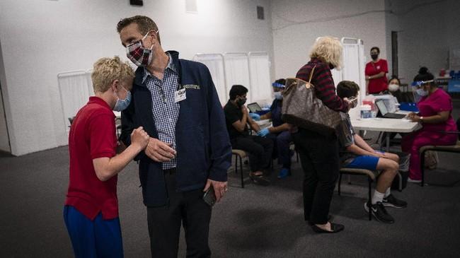 FOTO: AS Vaksinasi Anak Usia 12-15 Tahun Pakai Vaksin Pfizer
