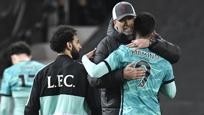 Liverpool mengalahkan Manchester United 4-2 dan meraih poin penting untuk lolos ke Liga Champions musim depan.