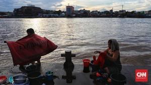 FOTO: Berbagi Kehidupan dengan Sungai Musi
