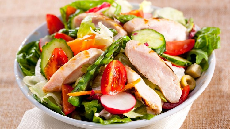 Grilled chicken with asparagus and spring vegetable salad