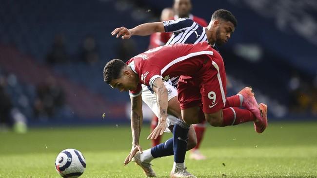 Sundulan Alisson Becker di masa injury time membuat Liverpool menang dramatis 2-1 atas West Bromwich Albion di Liga Inggris.