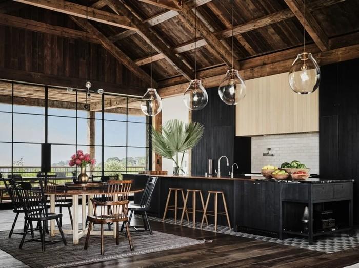 Rumah ini memiliki konsep yang minimal menggunakan sekat dan pintu. Seperti penampakan dapur dan meja makan yang berdampingan tanpa pembatas ruangan. (Foto: Douglas Friedman/Architectural Digest)