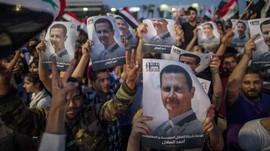 FOTO: Sorak Pendukung Assad Rayakan Kemenangan Pemilu Suriah